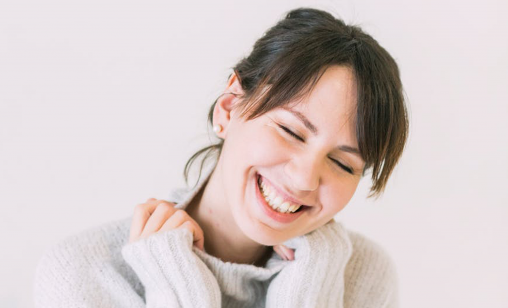 cheerful woman wearing turtle neck sweater