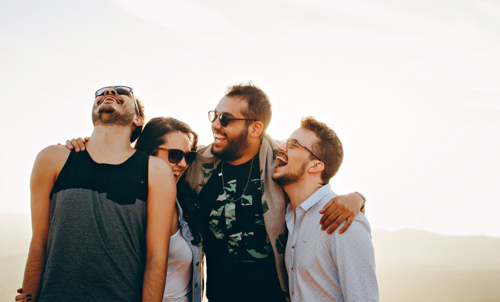 four persons wearing sunglasses
