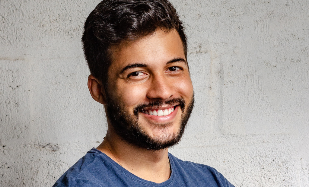 a man is showing off his unique smile
