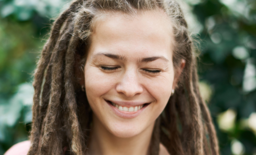 woman with dreadlocks is happy