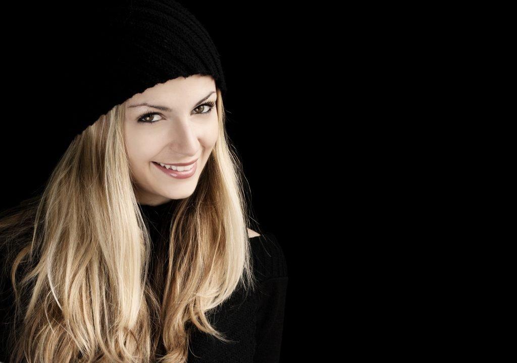 happy woman wearing black clothes and black bonnet