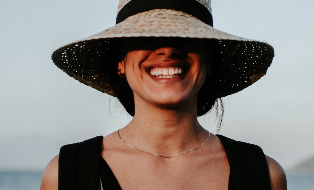 a cheerful woman wearing a hat