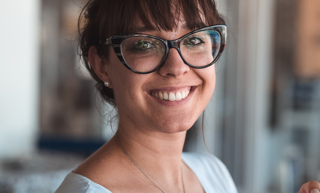 cheerful woman wearing an eyeglasses