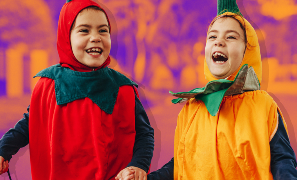 two happy kids are wearing a fruit costume