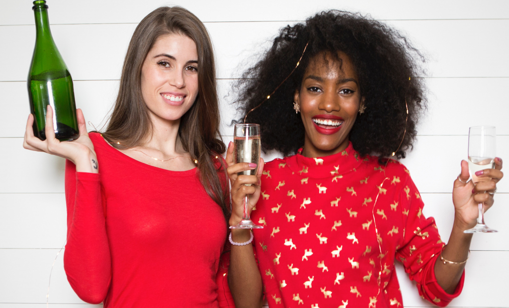 women holding glasses of wine is celebrating new year