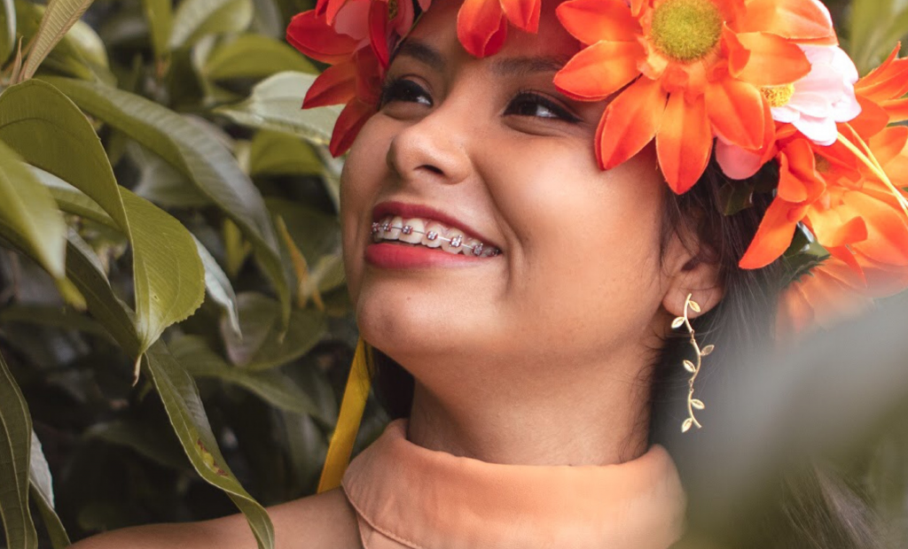 a woman with braces wearing a flower crown