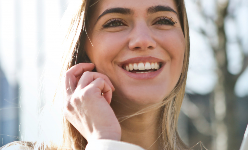 a cheerful woman showing her unique smile