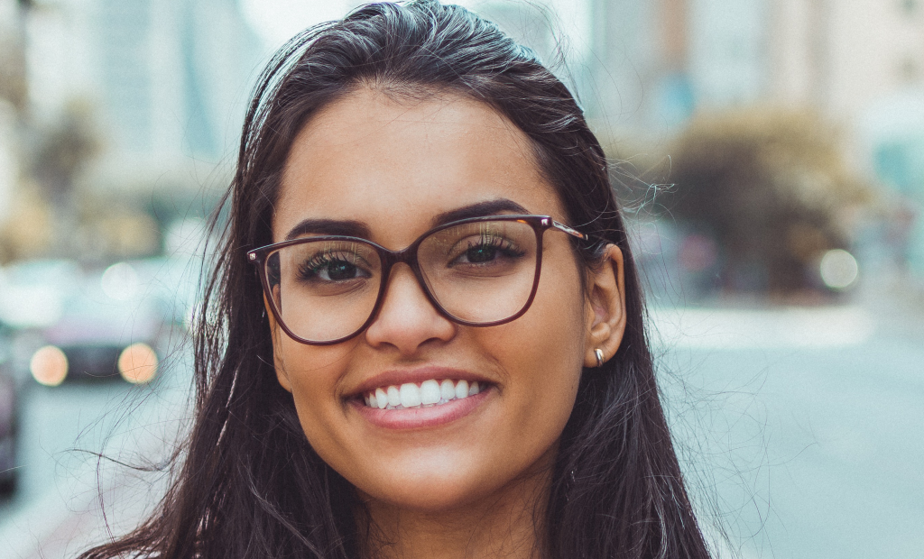 joyful woman wearing an eyeglasses is smiling