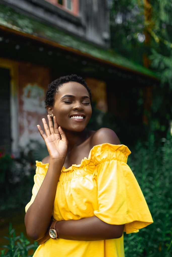 woman posing wearing yellow dress
