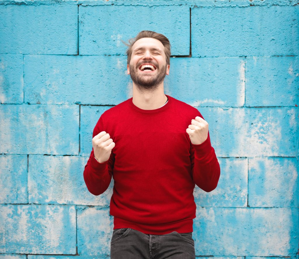 happy man wearing a red sweat shirt