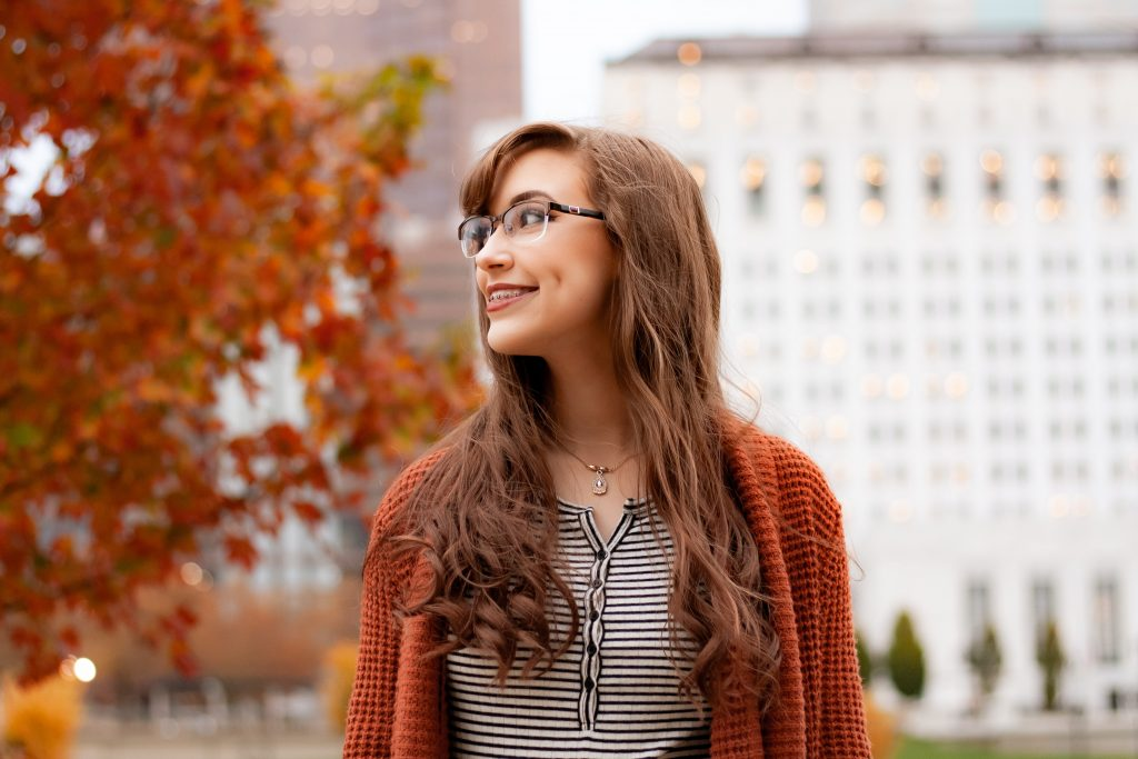 woman with dimples wearing an eyeglasses