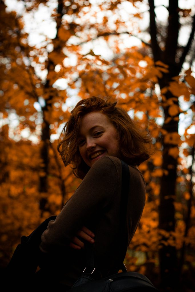 girl posing in the woods