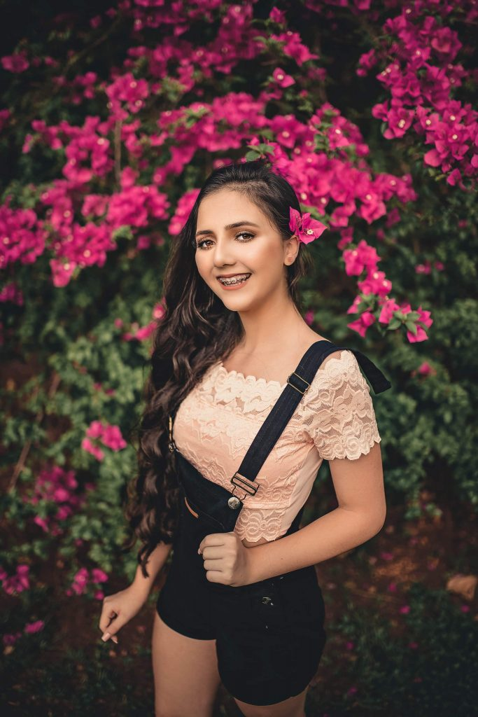 beautiful girl with braces posing in the garden