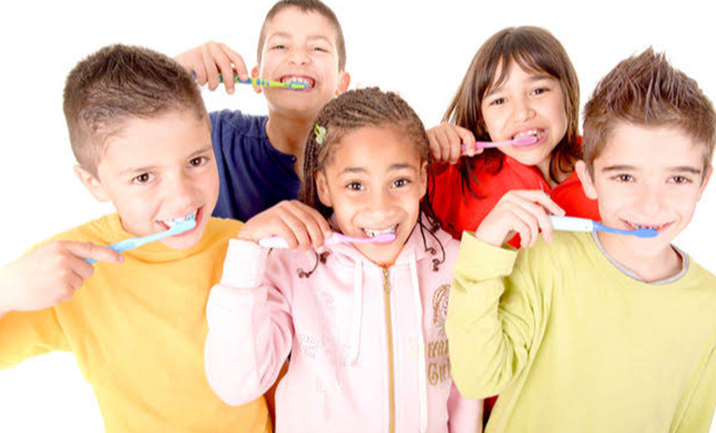 kids having their teeth brushed