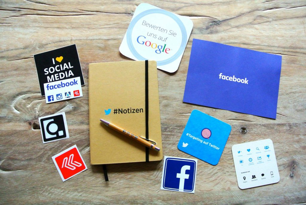 notebook and social media posters