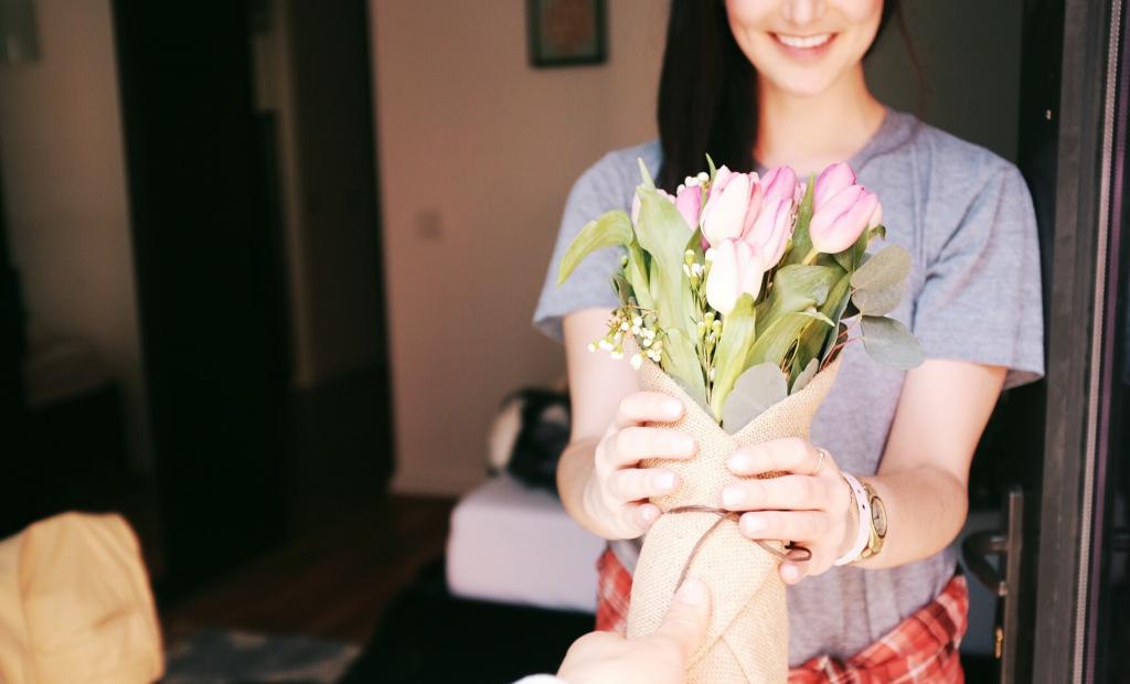 girl receiving bunch of tulips