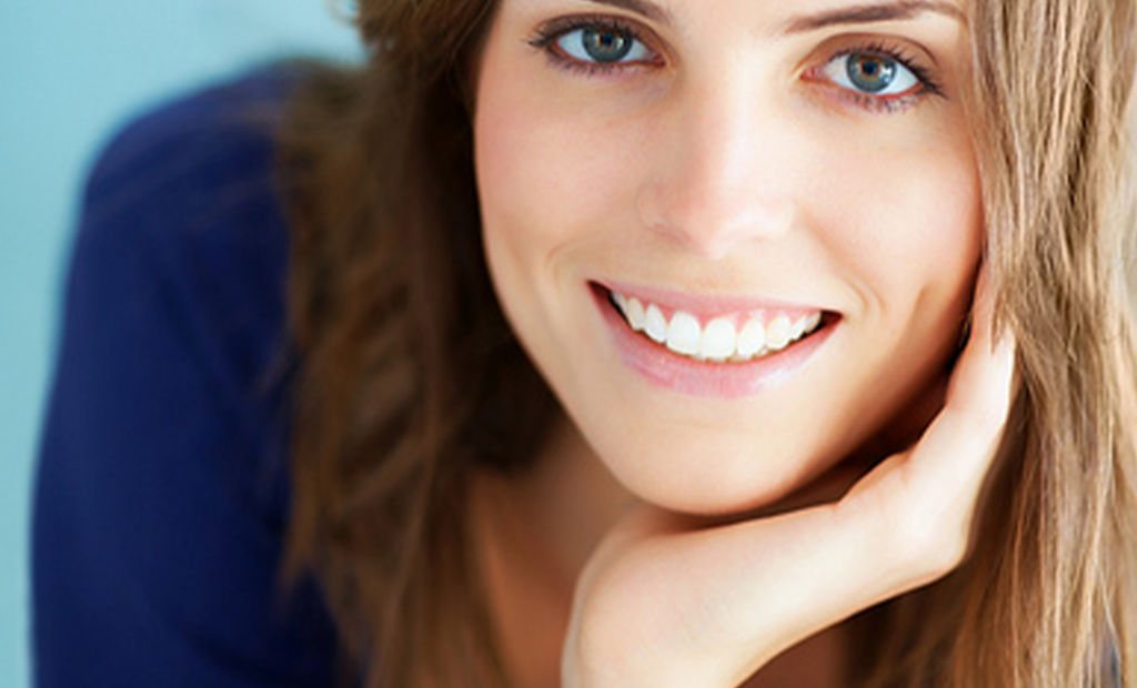 woman with tantalising eyes is smiling