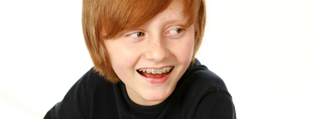 a kid wearing braces