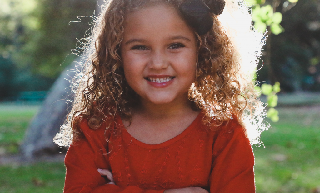 a cute kid with curly hair