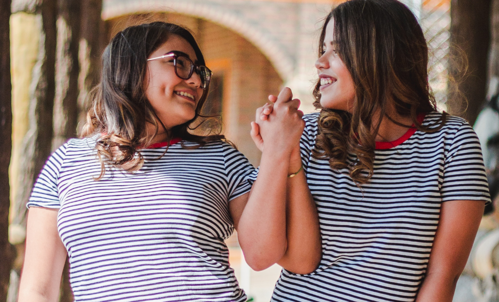 two girls wearing same shirt with stripes