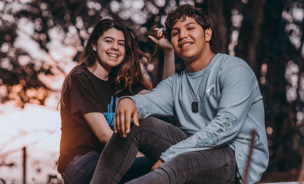 a boy and a girl showing their smile