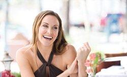 happy woman wearing a criss-cross top