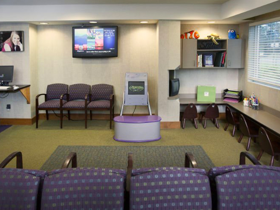 Dr. Whitlock Orthodontics gallery with violet chairs